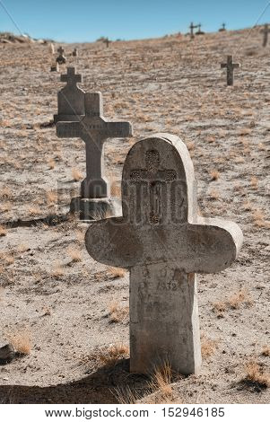 In the desert of New Mexico, the poor side of the cemetery gets no water.