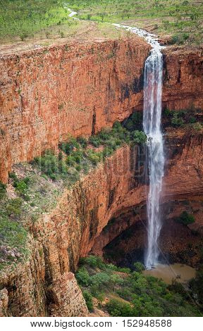 Un-named dual drop waterfall hidden away inside and behind the much photographed external escarpment of the Cockburn Range in the Kimberley of Western Australia.