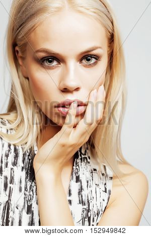 young pretty woman with blond hair on white background, sensual makeup, fashion sexy look, lifestyle people concept close up