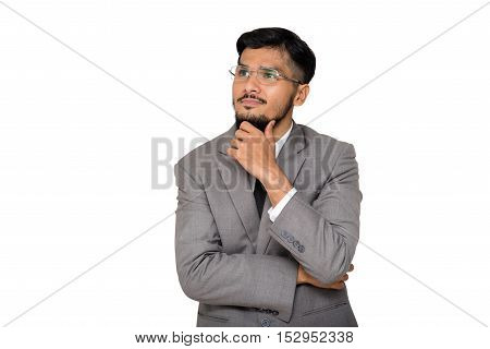 Confident young businessman isolated on white background.