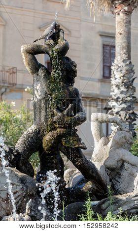TRAPANI ITALY - AUGUST 11 2016: Triton fountain on the Piazza Vittorio Emanuele II built in 1951 by Domenico Li Muli.