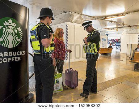 London, the UK-May 2016: Police on duty at Paddington station