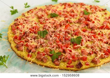 Pizza - the basis of zucchini ham and paprika. Healthy food. Close up
