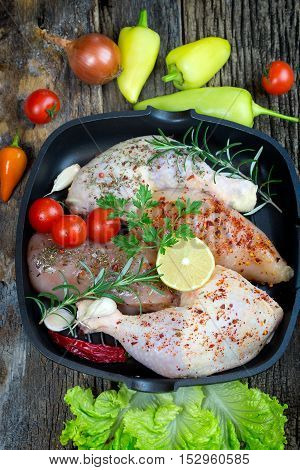 Raw chicken meat with spices (seasoning) - raw chicken drumstick and raw chicken breast