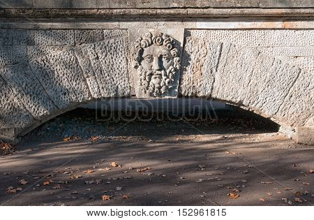 TSARSKOYE SELO, SAINT - PETERSBURG, RUSSIA - OCTOBER 19, 2016: The mask of ancient deity above the arch of the Ramp near Cameron Gallery in Catherine Park. The Tsarskoye Selo is State Museum-Preserve