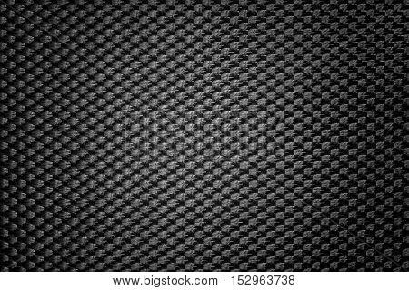 Black symmetrical synthetic fiber texture with vignette.