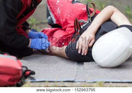Workplace accident. First aid after occupational injury. Hand injury.