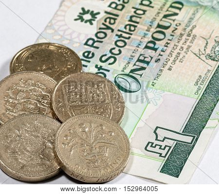Scotland, UK. 23 October 2016, UK pound coins on a Royal Bank of Scotland Pound (Sterling) note.