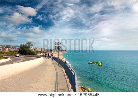 road on the sea shore Mediterranean Sea and sunny sky
