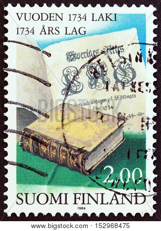FINLAND - CIRCA 1984: A stamp printed in Finland issued for the 250th anniversary of 1734 Common Law shows Statute Book and Title Page, circa 1984.