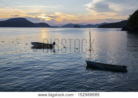 Beautiful landscape view of sea at twilight time with the small boat in the sea