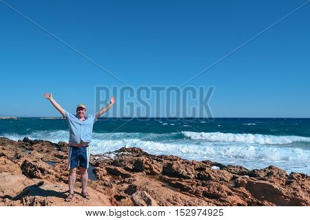 middle-aged man enjoying the warm sea breeze and stunning views of the ocean
