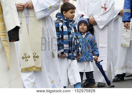 BUCHAREST ROMANIA - OCTOBER 23 2016: Altar servers are participating at the Eucharistic procession with the relic of Saint Pope John Paul II.