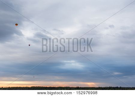 Aerial view of multicolored hot air balloons floating in the sky