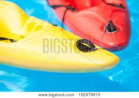Kayaks in water close up. Court shoes in the pool. Kayaks in the pool close up. Canoe in water close up. Two boats in the pool.