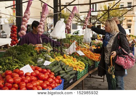 VIC, SPAIN - OCTOBER 10, 2016: fruit and vegetables for sale in the city of Vic. It is a colorful food and flower market, which is popular among locals and tourists.