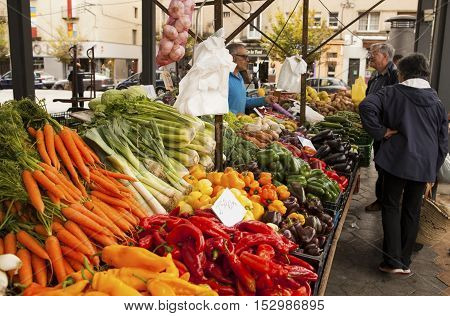 FIGUERES, SPAIN - OCTOBER 12, 2016: fruit and vegetables for sale at Figueres. Colorful food and flowers market which is popular with locals and tourists.