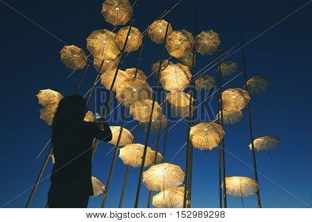 Silhouette Of A Girl Shooting The Umbrellas, Thessaloniki - Greece