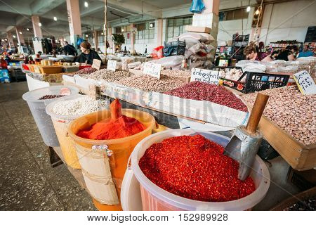 Batumi, Georgia - May 28, 2016: The Fragrant Spices In Big Containers And Raw Dry Beans For Sale On Market Counter.