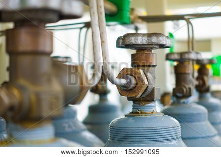 Head and valve of Nitrogen cylinder rack on selective focus.