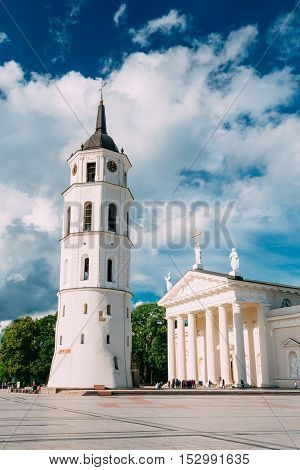 Vilnius, Lithuania. Cathedral Basilica Of St. Stanislaus And St. Vladislav With The Bell Tower In Summer Sunny Day,  Blue Cloudy Sky Background. Roman Catholic Cathedral At The Cathedral Square.