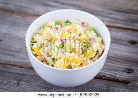 citrus couscous salad with chick peas on table
