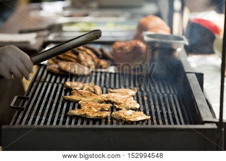Sizzling Meat Being Cooked on a Barbecue Grill. Street food and bbq concept