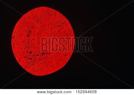 Red is almost a circle on a black background