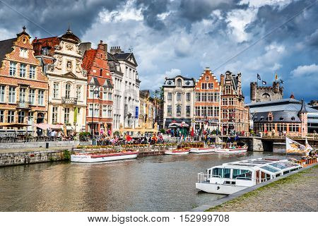 GENT (GHENT) BELGIUM - 11 AUGUST 2014: Panoramic view from the St. Michael Bridge to the architecture the Leie river in the historic city center with channel and embankment (Graslei and Korenlei)