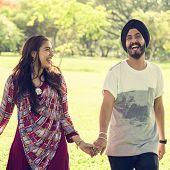 Couple Indian Ethnicity Park Companionship Concept poster