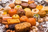 Mix Mithai or indian milk made sweets, favourite diwali, holi, dussehra, indian or pakistani wedding sweet food served in a square silver decorative plate poster