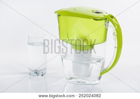 Burgas, Bulgaria - August 3, 2018 - Aquaphor Water Filtration Pitcher And Glass Of Water On White Ba