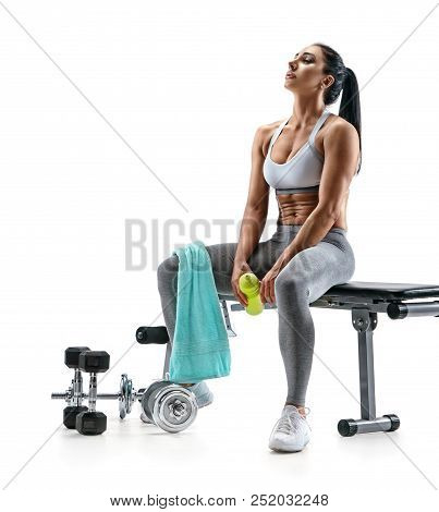 Resting Time. Tired Sporty Woman Resting After Training. Photo Of Fitness Model With Towel And Prote