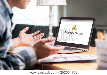 Page Not Found And Error In Laptop. Bad Or Slow Internet Connection. Frustrated Man Spreading Hands