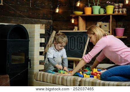 Education Concept. Little Child Play Educational Game With Woman, Education. Childcare And Education