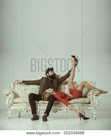 Friendship. Friendship Of Bearded Man And Sexy Woman Injoy At Sofa. Friendship Relations Of Stylish