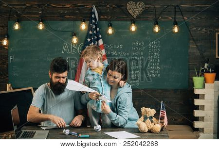 Fun Concept. Family Have Fun In Class. Little Child And Parents Enjoy Folding Paper Planes. Learning