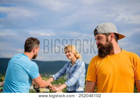 Hipster Regretful Face In Front Of Couple In Love. Man Hipster Feels Lonely Couple Dating Behind Him