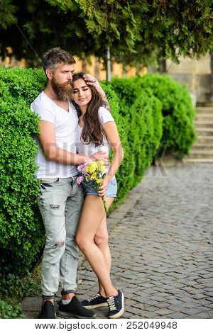 Man Bearded Hipster Hugs Gorgeous Girlfriend. Park Best Place For Romantic Walk. Couple In Love Roma