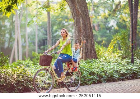 Happy Family. Family Sport And Healthy Lifestyle -happy Mother And Son Riding A Bicycle Together Out