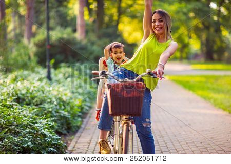 Happy Family Family Sport And Healthy Lifestyle- Boy On Bike With Smiling Mother - Lovely Family Hav
