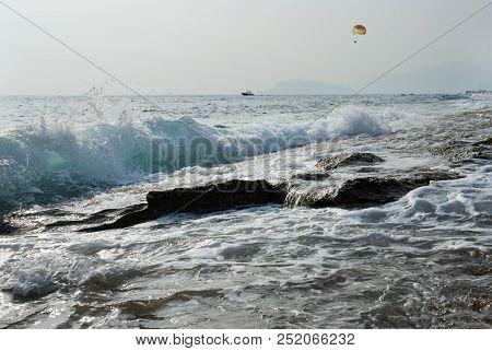 Mediterranean Sea Coast, Wave, Water Spray, Parachutist Over The Sea Behind The Boat, Turkish Coast