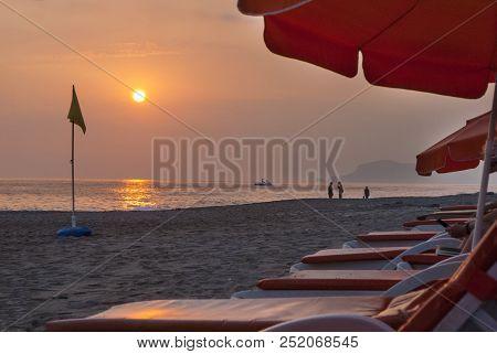 Sunset On The Sea Coast, Mediterranean Coast,  Sun,  Flag, Boat In The Sea, People On The Shore