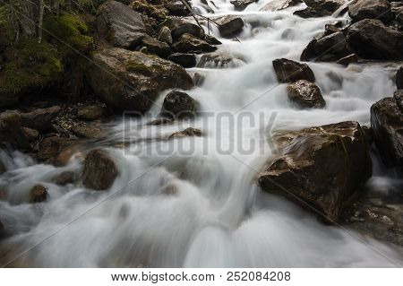 Mountain Brook In Alps, The Highest And Most Extensive Mountain Range System That Lies Entirely In E
