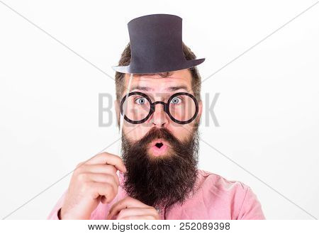 Man Bearded Hipster Hold Cardboard Top Hat And Eyeglasses To Look Smarter White Background. Signs So