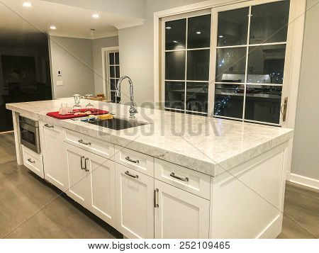 kitchen island with white cabinets, modern under mount sink and faucet and granite countertop in white kitchen, home interior kitchen design, white kitchen design, modern looking kitchen design