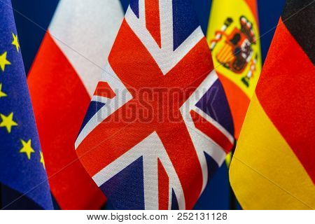 Flags Of Germany, Usa, Great Britain, Spain, Poland And United Europe. Concept Of International Rela