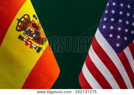 Flags United State Of America And Spain With Green Background. Concept Of International Relations.