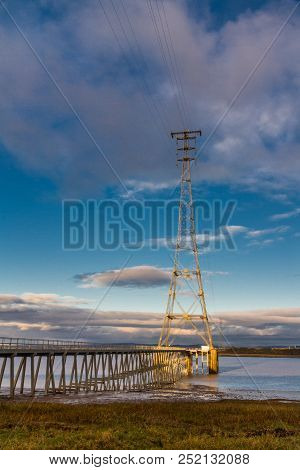High Electrical Pylon Next To The Severn Crossing, Aust, United Kingdom. Morning Light.
