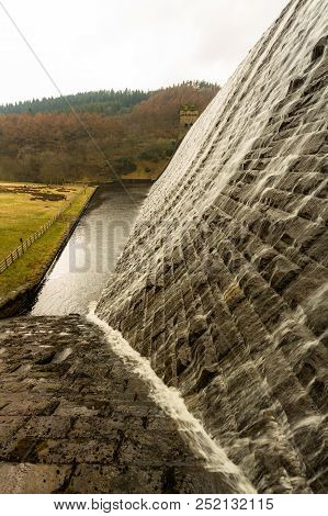Water Cascading Down Stone Dam, Ladybower Reservoir.
